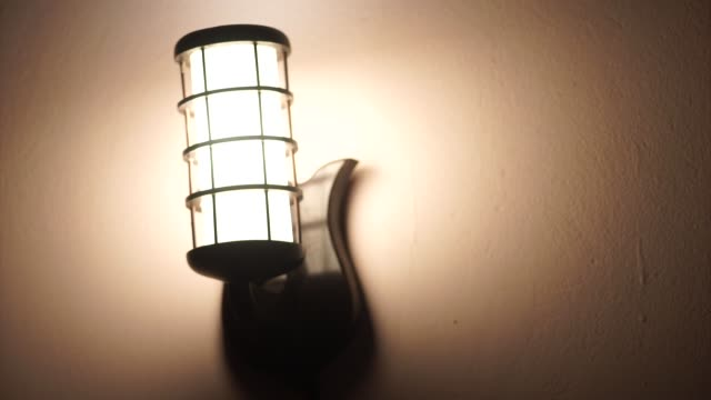 Turning On And Off Old Fashion Electric Lamp Hanging On Wall Turning On Or Off ,Old Fashion, Electric Lamp ,Hanging , Wall,VietNam low lighting stock videos & royalty-free footage