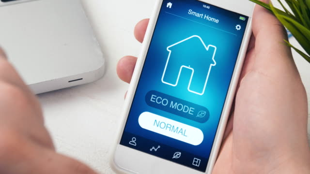Turning on ECO mode in the Smart House using smartphone application Man turns on ECO mode in his Smart House using smart home application on his smartphone ecosystem stock videos & royalty-free footage