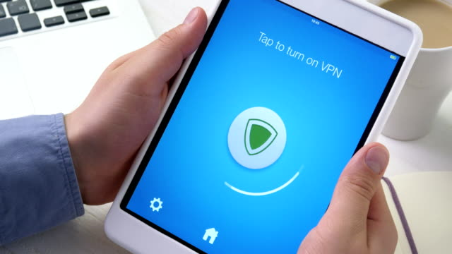 Turning on VPN on digital tablet for secure internet surfing video