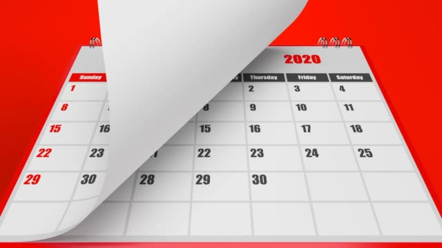 turning pages of calendar 2020 year on red background - marzo video stock e b–roll