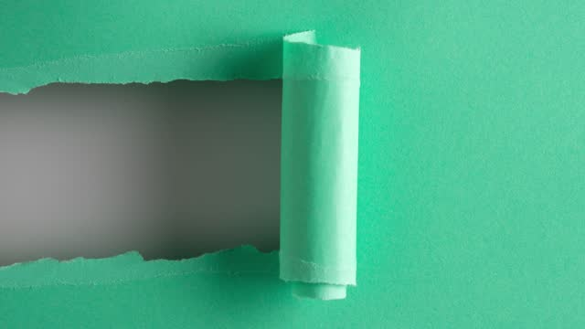 Turquoise paper is torn over white background for message, stop motion, animation. Template for your text.