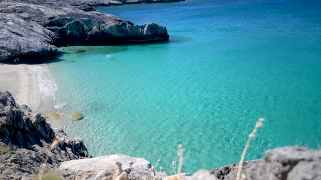 Turquoise water on amazing Ammoudi Beach in Crete island, Greece Turquoise water on amazing Ammoudi Beach in Crete island, Greece greek islands stock videos & royalty-free footage