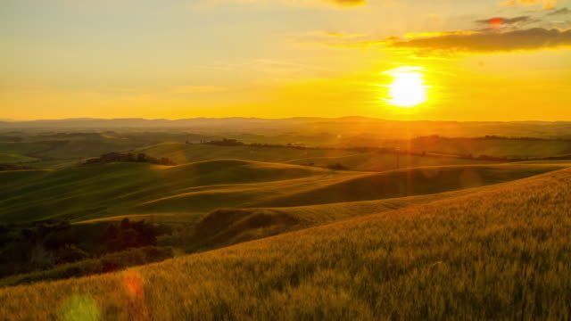 T/L Tuscany countryside in the sunrise Time lapse shot of the Tuscany countryside in the sunrise. Tuscany. Florence. Italy. The footage was shot in raw. Also available in 5K resolution. sunrise dawn stock videos & royalty-free footage