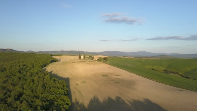 Tuscany landscape with old little chapel at sunset video