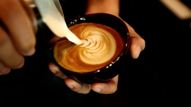 tutorial barista making art latte, slow motion - milchschaum kunst stock-videos und b-roll-filmmaterial