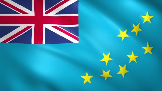 tuvalu flag waving in the wind - insygnia filmów i materiałów b-roll