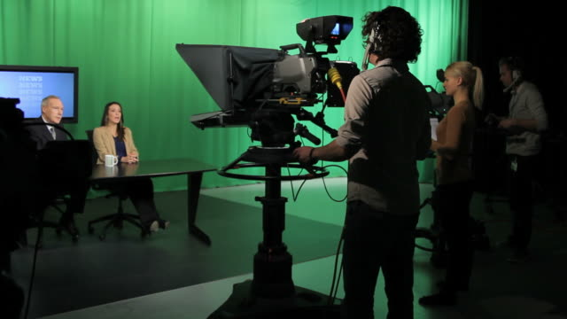 Tv presenters and crew in television studio video