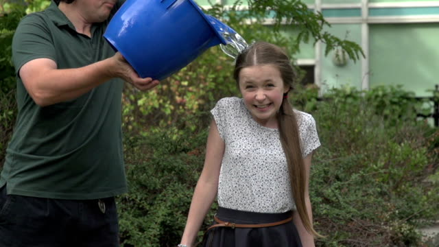 Tween girl take the ice bucket challenge - slow motion video