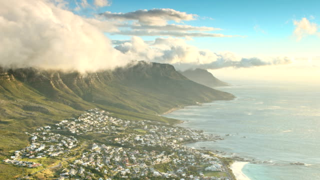 Twelve Apostles Time Lapse Time lapse of the South Easterly wind, known locally as the 'Cape Doctor', blowing banks of clouds over the Twelve Apostles and the affluent neighborhood of Camps Bay in Cape Town.  table mountain national park stock videos & royalty-free footage