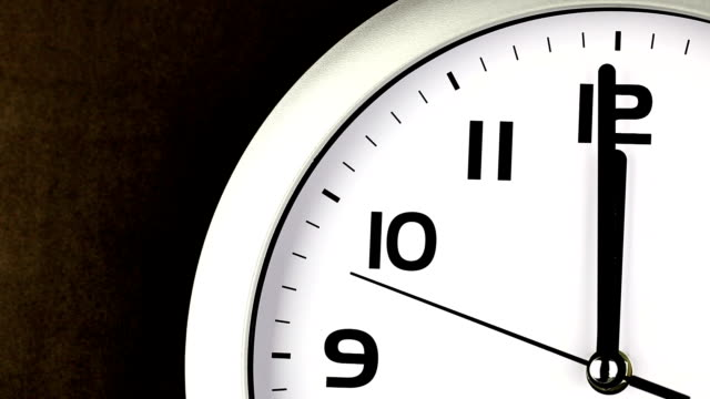 Twelve O'clock Clock - ticking clock Macro clip of a black and white clock on a brown background ticking down the last seconds before 12 o'clock - concept clip for running out of time, last minute, deadlines, stress, midnight, midday. midday stock videos & royalty-free footage