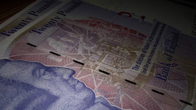 twenty british pound bills - close up video