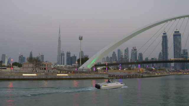 twilight dubai famous water canal traffic bridge motor boat ride downtown panorama 4k united arab emirates video