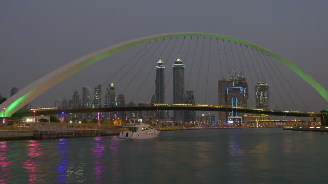 twilight dubai famous water canal traffic bridge yacht ride downtown panorama 4k united arab emirates video
