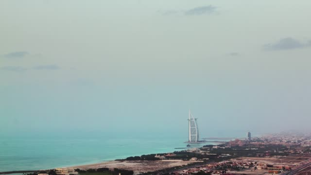 twilight dubai marina world famous hotel roof top panorama 4k time lapse united arab emirates - 7 star stock videos and b-roll footage