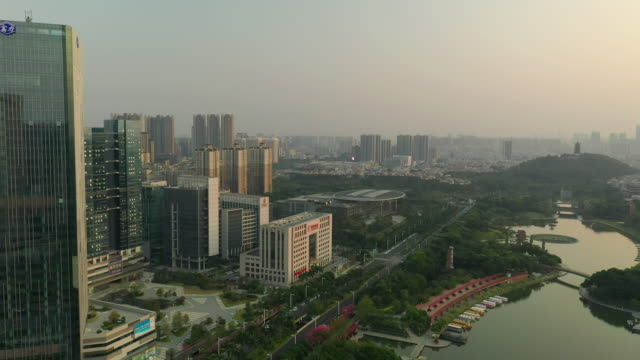 twilight time foshan city downtown building front famous park river aerial panorama 4k china