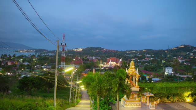 twilight time illumination samui island beach town famous temple complex rooftop panorama 4k timelapse thailand
