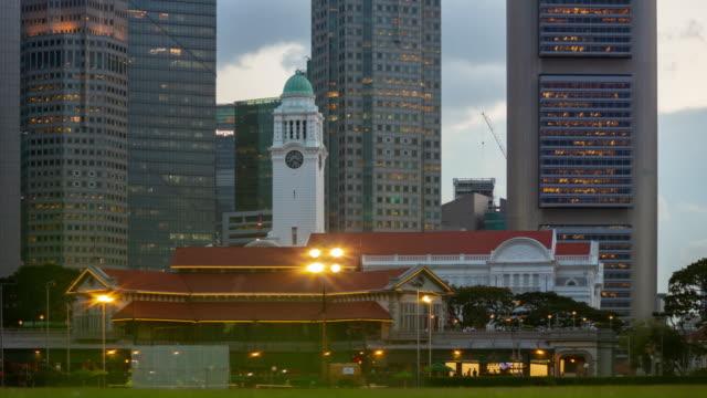 twilight time illumination singapore city center downtown buildings front panorama timelapse 4k - stile del xix secolo video stock e b–roll