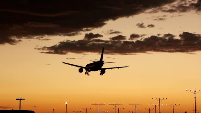 Twin engine jet plane dusk landing video