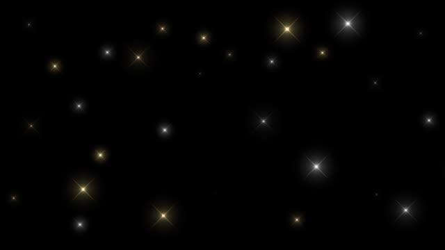 twinkle of brilliant multicolored stars on a black background hd - kształt gwiazdy filmów i materiałów b-roll