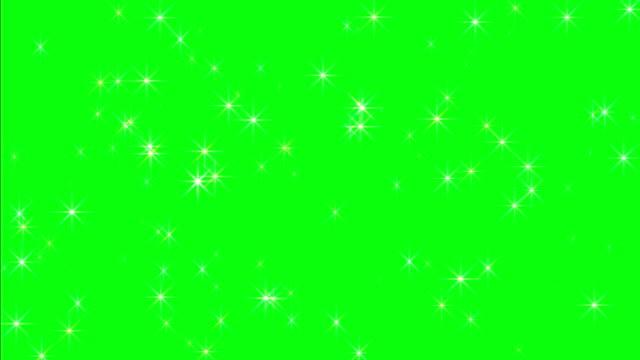 yeşil ekranda pırıltılı yıldızlar - işıltılı stok videoları ve detay görüntü çekimi