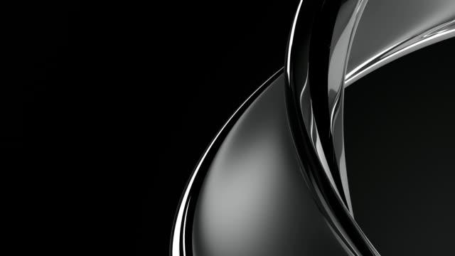 扭曲的銀色金屬魅力環 - {{asset.href}} 個影片檔及 b 捲影像