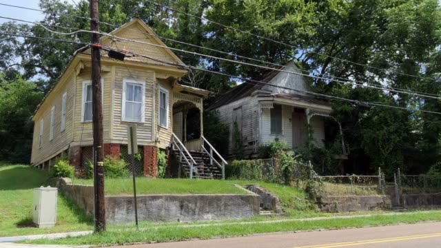 Two Abandoned Houses In Natchez Mississippi United States Old abandoned buildings in downtown Natchez, Mississippi, United States of America. Economic crisis and depression with empty wooden houses and homes south stock videos & royalty-free footage