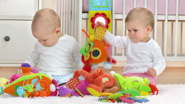HD: Two Adorable Toddlers Playing With Toys video