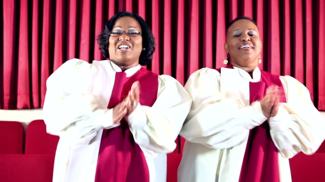 Two African-American women singing in church choir video