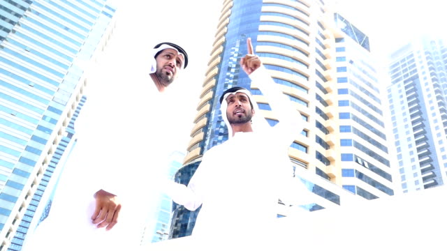 Two arab business people discussing on the street -slowmotion video