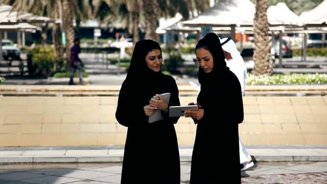 Two Arabian Businesswomen Outdoors Beautiful Arabian Businesswomen Discussing middle east stock videos & royalty-free footage