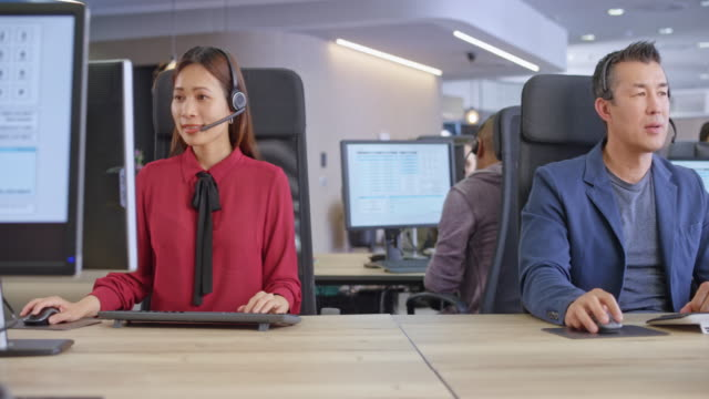 DS Two Asian call centre agents working at their stations video