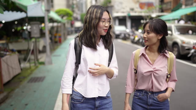 two asian students on their way to school - two students together asian video stock e b–roll
