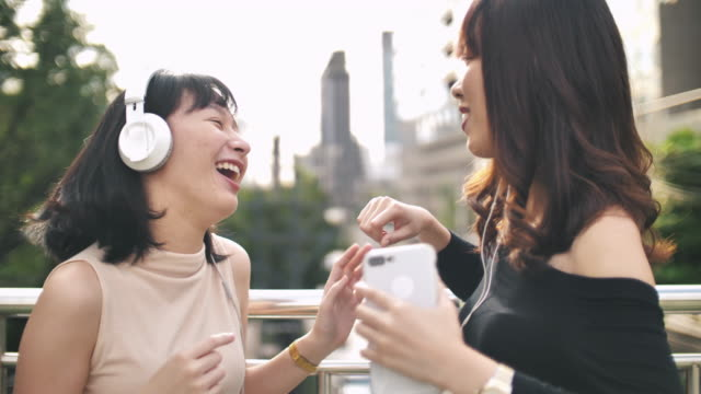 Two Asian Woman Enjoy to Music