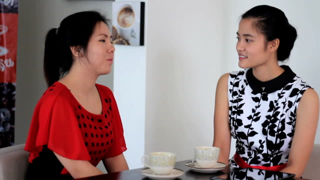 Two Asian Women Spending Time In A Coffee Shop video