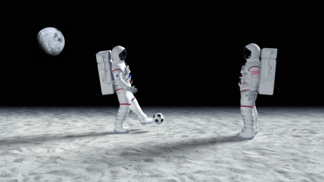 Two Astronauts Playing Soccer On The Alien Planet Surface