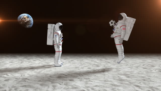 Two Astronauts Playing Soccer On The Moon Surface