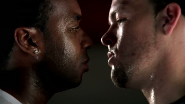 Two atheletes stare intensely at each other  face to face stock videos & royalty-free footage
