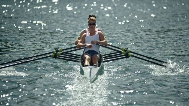 Two athletes rowing in a double scull on a sunny day video