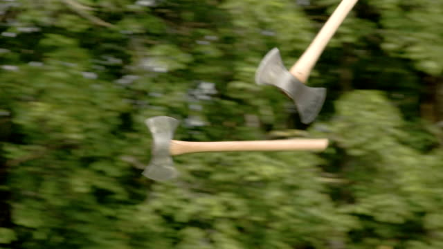 Two axes flying and thrown on the logboard video