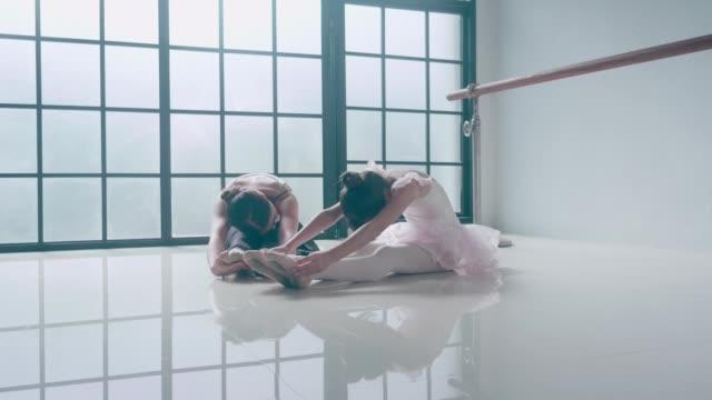Two Ballerinas Stretching leg