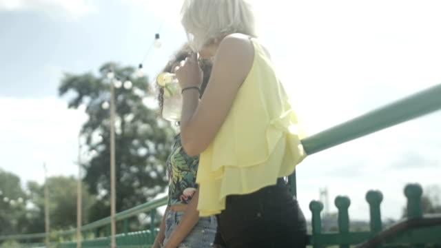 two beautiful young girls enjoying summer. - balaustrata video stock e b–roll