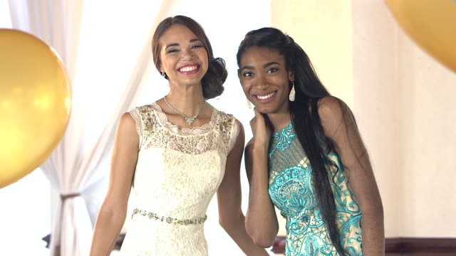two beautiful young women wearing prom dresses - prom stock videos and b-roll footage