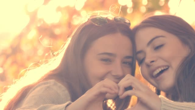 Two bff best friends young woman laughing enjoying life outdoors autumn fall video