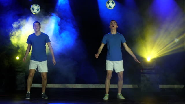 two boys juggling ball video