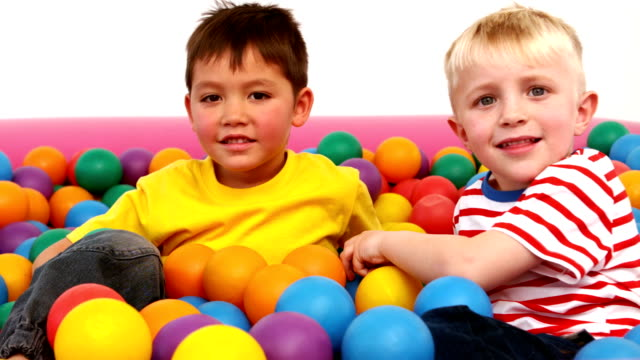 Two boys playing in a ball pit video