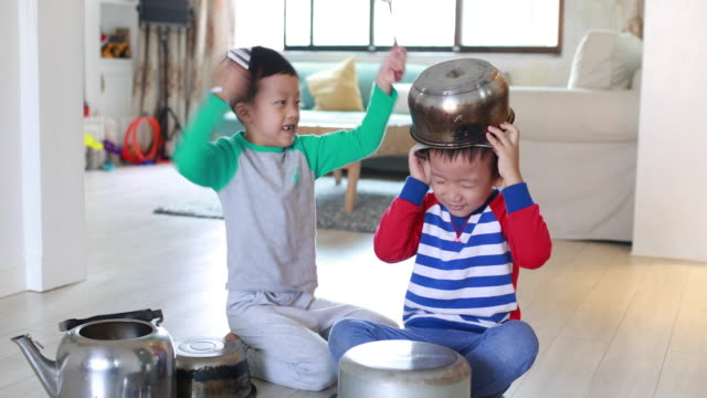 Two brother playing on floor with pots and pans Two brother playing on floor with pots and pans cooking pan stock videos & royalty-free footage