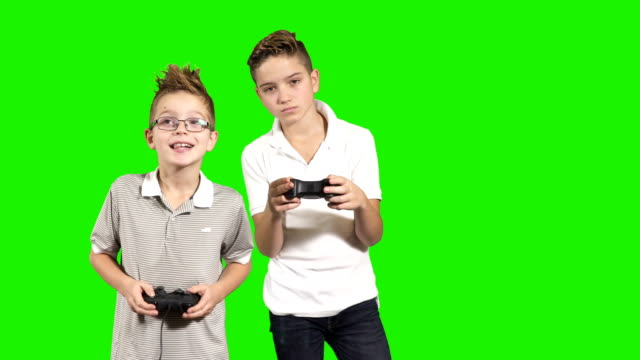 Two brothers plays at video game with gamepads video