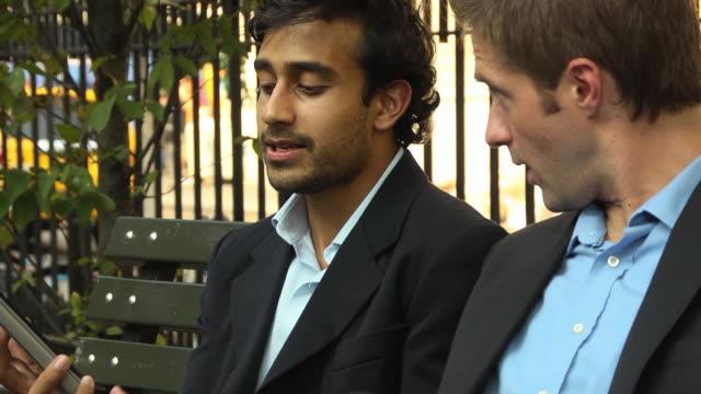Two Businessmen Brainstorming on a Digital Tablet Computer - CU video