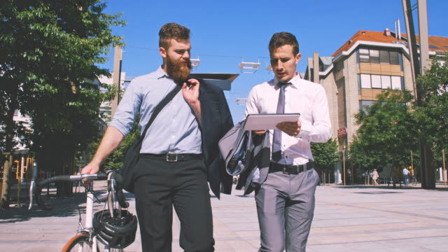SLO MO Two businessmen using digital tablet in the city video