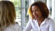 istock Two Businesswomen Meeting Around Table In Modern Office 878745040
